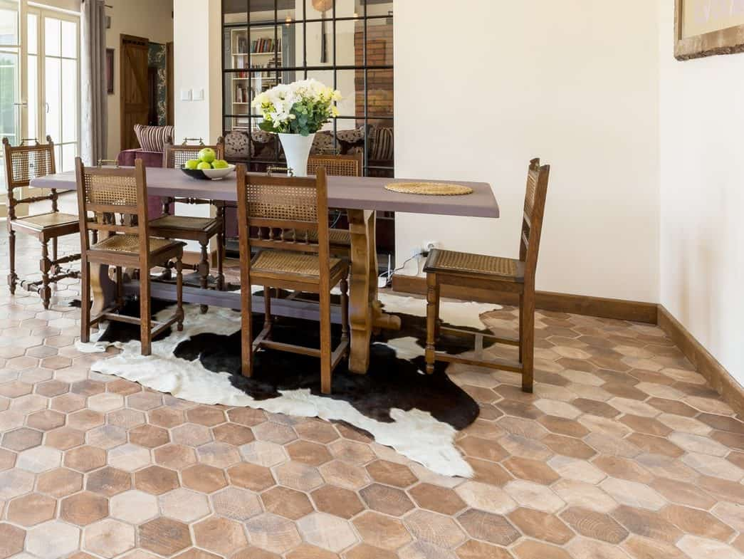 Spacious dining room with rustic tiles